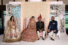 Indian bride and Raja taking pictures with guests