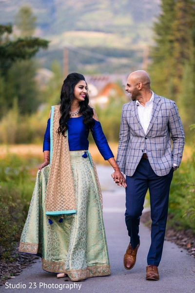 Joyful maharani holding hands with Raja