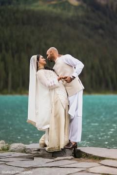 Tender moment between the lovebirds