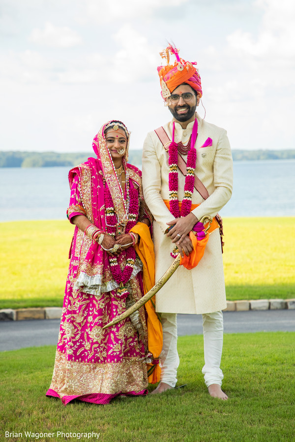 Indian bride and groom posing outdoors