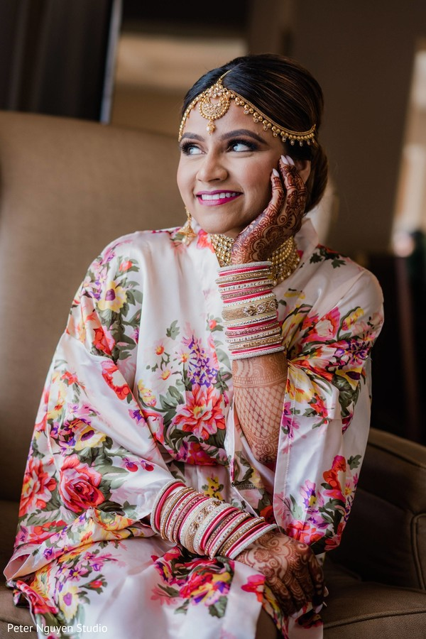 Cute Indian bride getting ready photo.