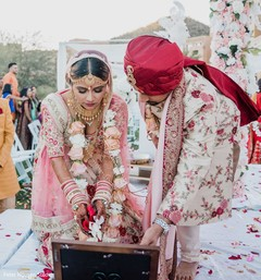 Indian bride and groom pouring offerings to sacred fire.