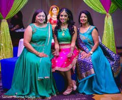 Beautiful Indian bride posing with special guests