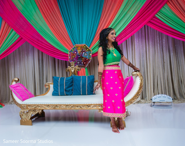 Dazzling Indian bride posing under the decor