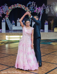 Indian bride and groom sliding through the dance floor