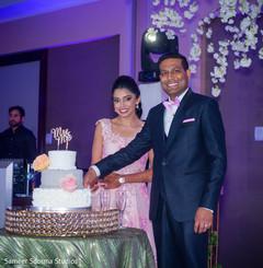 Ravishing Indian couple cutting the cake