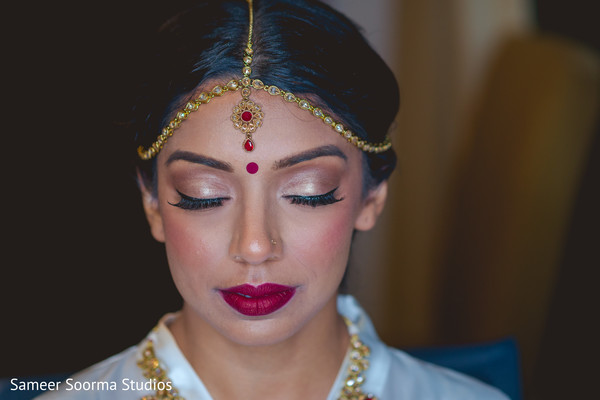 Dazzling Indian bride showing her make up