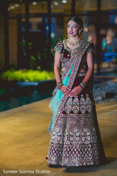 Indian bride outdoors with the beautiful lengha
