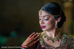 Indian bride showing her stunning mehndi and jewelry