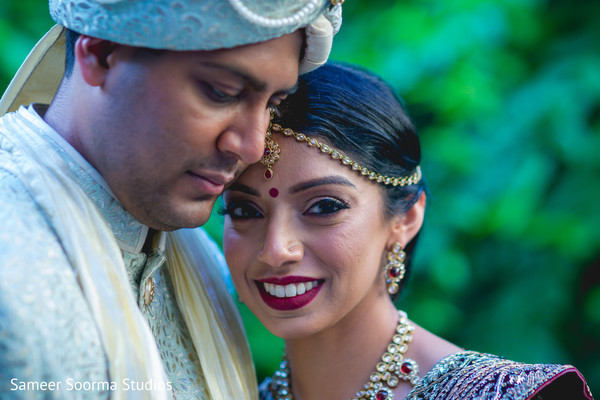 Dazzling Indian bride and groom outdoors