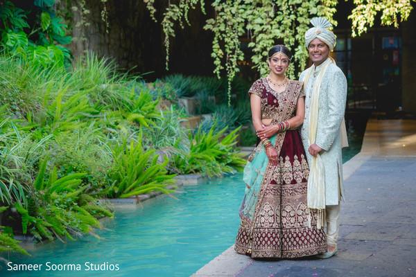Maharani and Raja posing by the water
