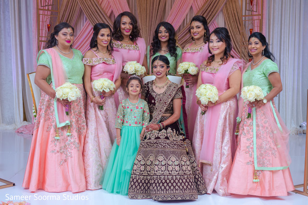 Bridesmaids posing with the dazzling Maharani