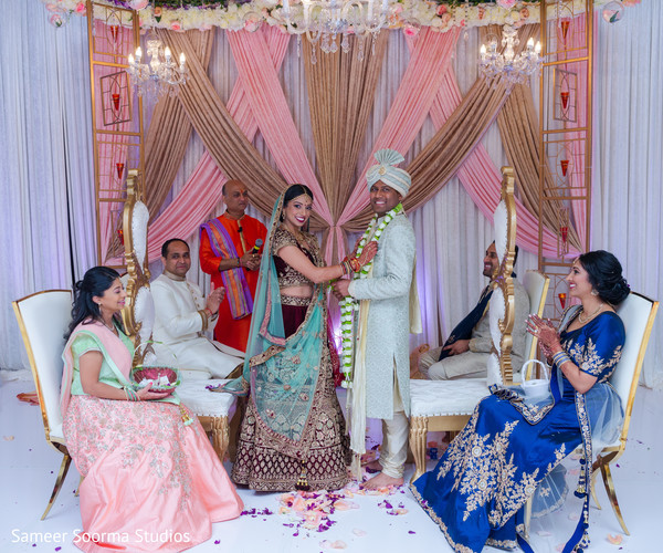 Indian couple posing for pictures at the ceremony