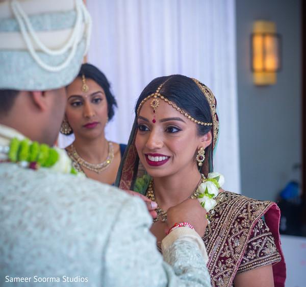 Smiling Maharani receiving the garland from Raja
