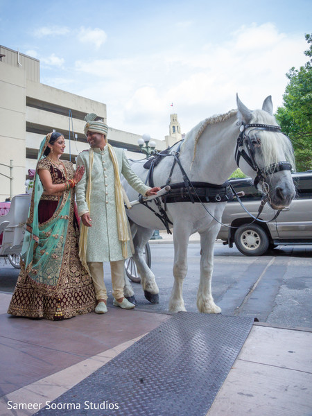 Indian bride and groom outside the venue