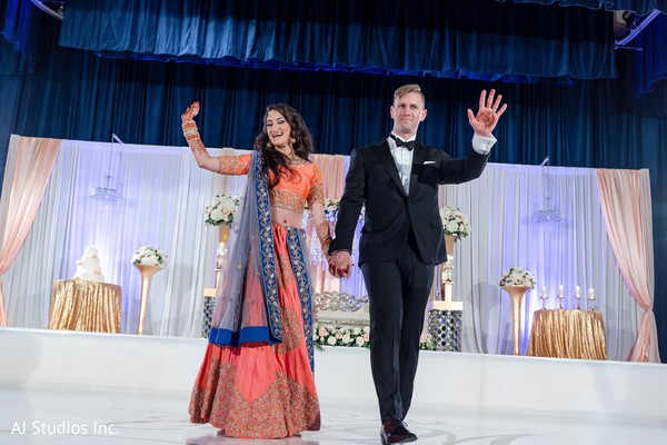 Indian lovebirds making their entrance to reception party.