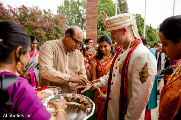 Indian groom being blessed at the baraat rituals.