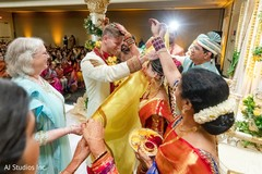 Indian groom being uncovered from antarpat.