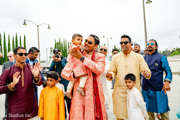 Great capture of Indian groomsmen at the baraat procession.