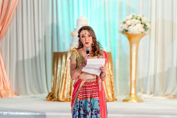 Indian bridesmaid at reception speech.
