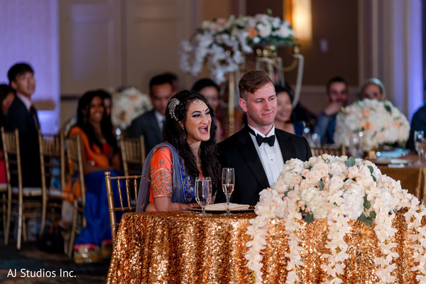 Joyful Indian bride and groom at reception.