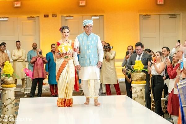 Indian bride walking down the aisle capture.