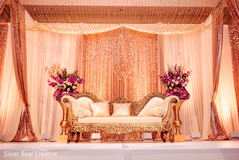 Magnificent Indian wedding reception stage decoration.