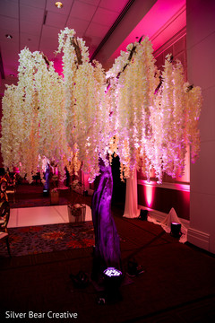 Stunning Indian wedding reception flowers decor.