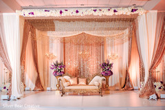 Wonderful Indian wedding stage flowers and draping decor.