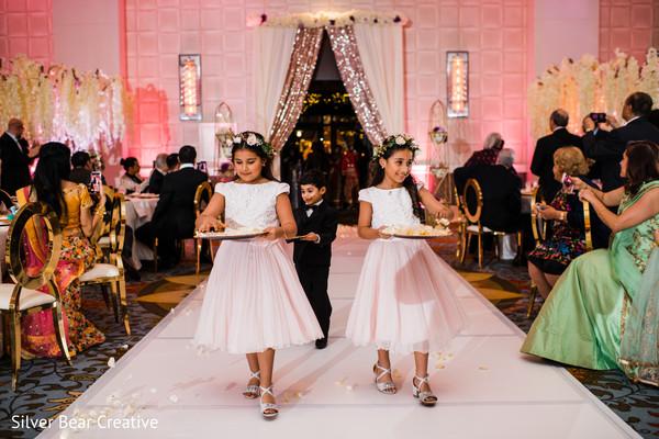 Lovely Indian wedding flower girls walking into ceremony.