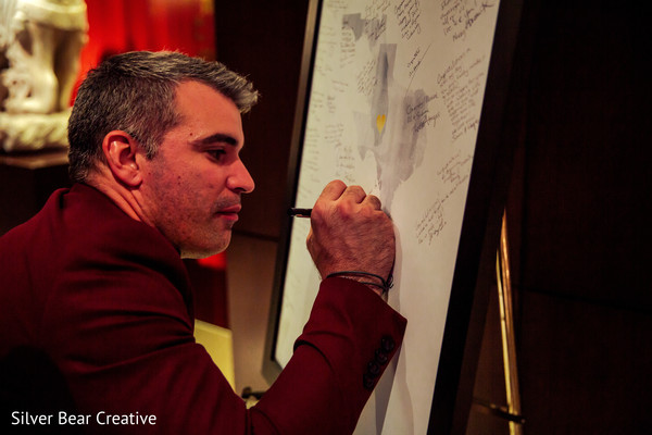 Wonderful capture of Indian wedding guest signing guest book.