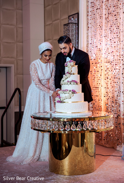 See this indian wedding cutting cake photography.