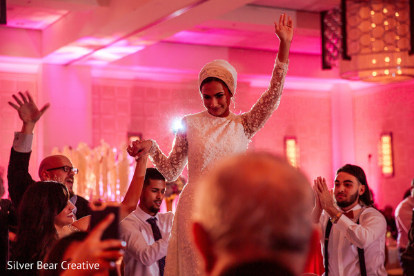 Upbeat Indian wedding reception scene.