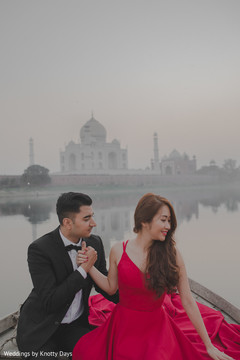 Indian bride and groom by the river