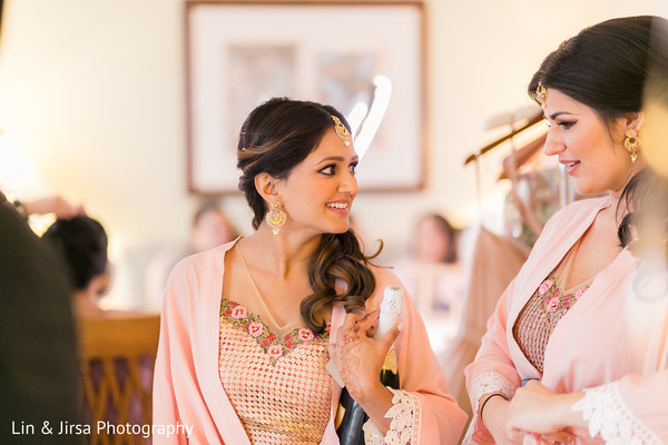 Sweet capture of Indian bridesmaids about to celebrate.