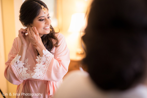 Indian bridesmaid getting her jewelry on.