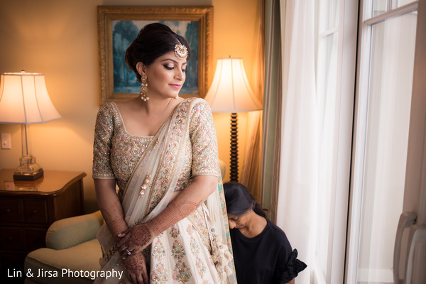 Enchanting Indian bride getting ready for her dreamy wedding.