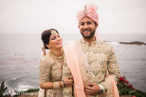 Cute Indian bride and groom's first look capture.