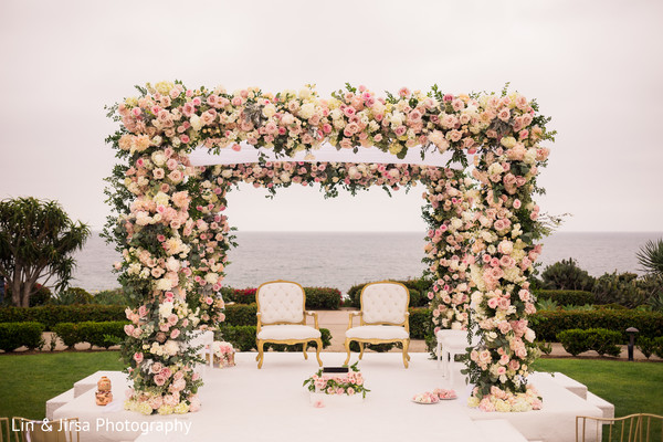 Stunning mandap decoration with pink flowers.
