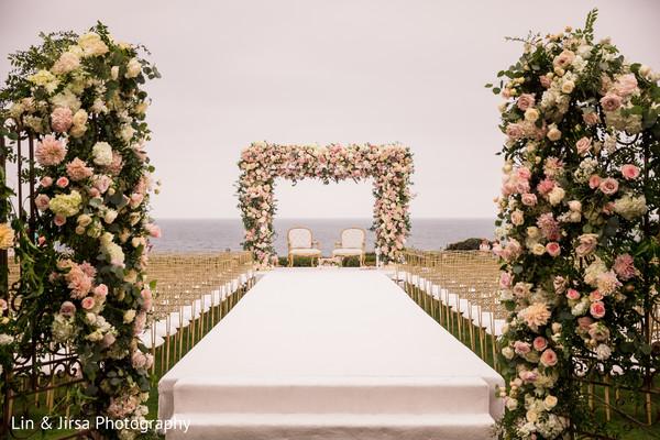 Stunning Indian wedding ceremony aisle capture.