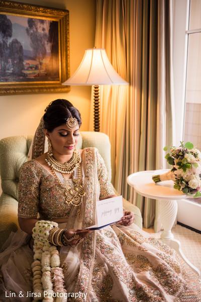 Indian bride reading grooms card.