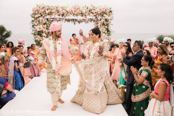 Maharani and Rajah walking down the ceremony aisle.
