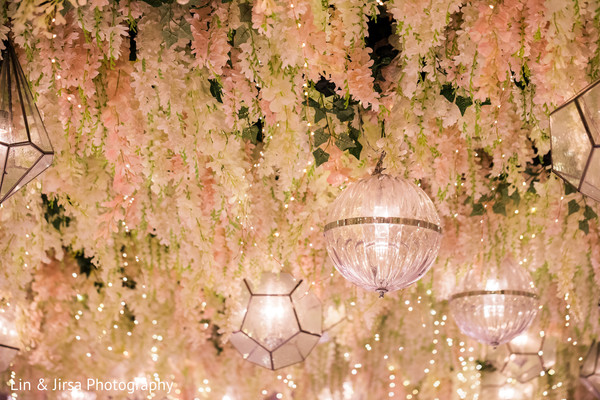 Elegant Indian wedding reception flowers and lamps decoration.