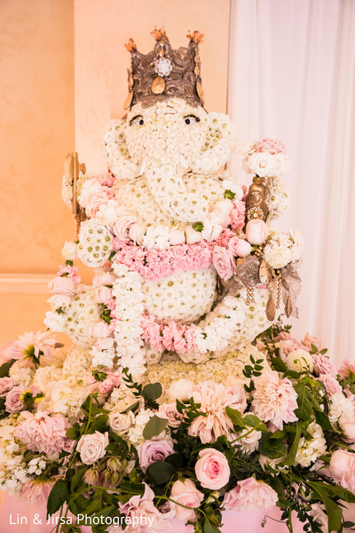 Stunning Indian ceremony Ganesha Puja flowers decoration.