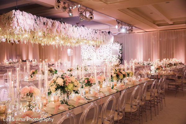 Dreamy Indian wedding reception table flowers and decoration.