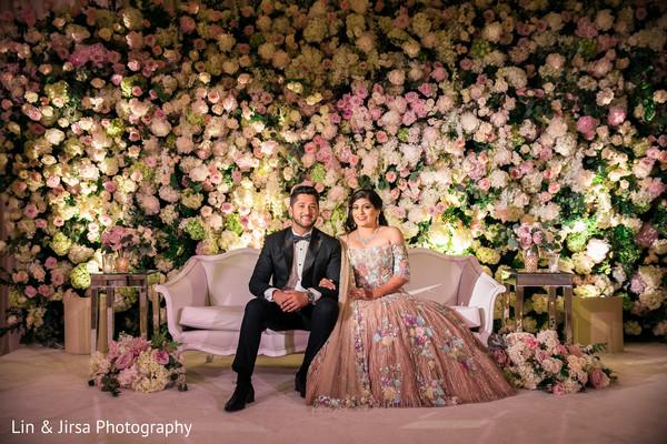 Ravishing Indian couple on their wedding reception attire.