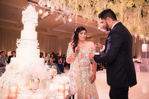 Lovely capture Indian groom giving cake to the bride.