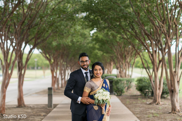 Indian couple taking pictures outdoors