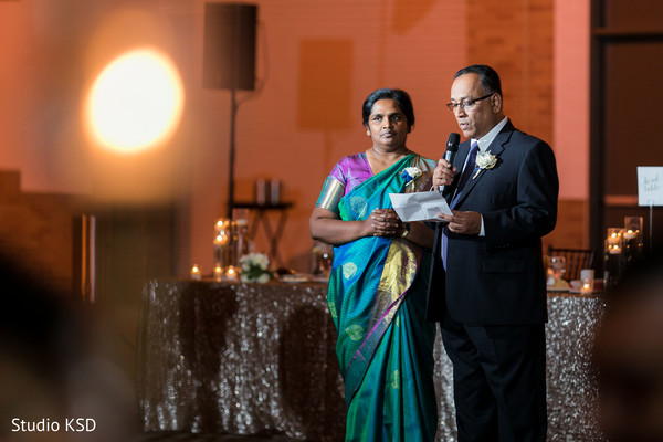 Parents delivering a speech for the guests