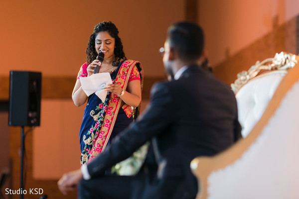 Indian newlyweds listening carefully to the guest